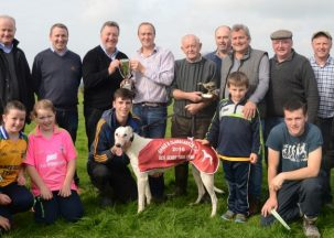 In the centre at the back  Brian Bradley presents the Tosser Perpetual Cup to Noel Hehir from Inagh Co.Clare after winning the Reserve Dog Trial Stake at the Ennis/Clarecastle Coursing Meeting. with  IVY HILL TRAD. also included at the back are from the left D.J. Histon I.C.C., Joe Carey,Michael McGuane,David Hehir, Paul Meekom  ( Lovejoy ),Liam Daly,John Browne and Pat McInerney. In  front are young friends and supporters.